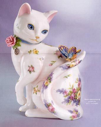 Painted porcelain cat figurine