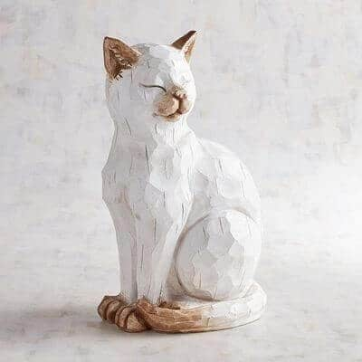 Winking cat sculpture